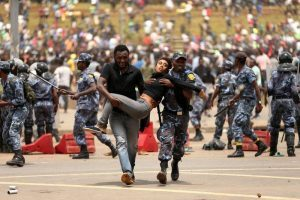 Police fire tear gas at protesters during state funeral for Ethiopia's Grand Dam engineer : IN PICTURES
